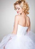 Beautiful bride portrait wearing professional make-up smiling Stock Photos