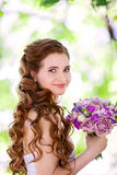 Beautiful bride. Portrait of beautiful bride with wedding bouquet in the hands Royalty Free Stock Images