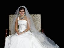 Beautiful bride posing for the camera. Stock Photos