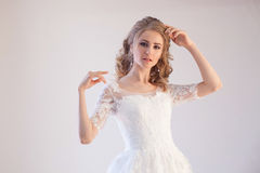 Beautiful bride posing hairstyle and dress Royalty Free Stock Photo