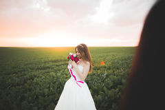 Beautiful bride posing on her wedding day in park Stock Photography