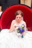Beautiful bride posing in her wedding day Royalty Free Stock Photos