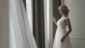 Beautiful bride posing in her wedding dress stock video footage