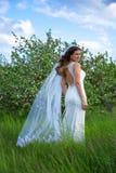 Beautiful bride posing near blooming apple tree Royalty Free Stock Photo