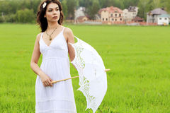 Beautiful bride posing outdoors. Stock Photo