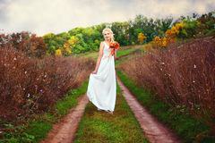 Beautiful bride posing outdoors with a bouquet Royalty Free Stock Photography