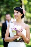 Beautiful bride posing outdoors on wedding day Royalty Free Stock Photo