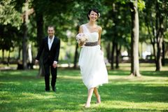 Beautiful bride posing outdoors on wedding day Stock Image