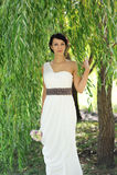 Beautiful bride posing outdoors on wedding day Royalty Free Stock Photo