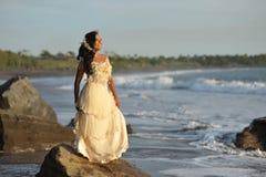Beautiful bride posing at sea coast Stock Image