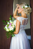 Beautiful bride posing. In Studio with a bouquet of flowers Royalty Free Stock Photos