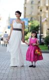 Beautiful bride posing together with flowergirl. Princess Stock Photo