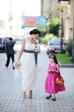 Beautiful bride posing together with flowergirl. Princess Royalty Free Stock Photos