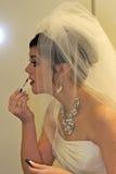 Beautiful bride preparing for wedding. stock photo