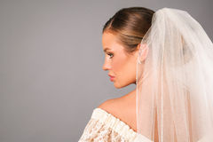 Beautiful bride profile wearing a veil in studio Stock Images