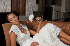 Beautiful Bride Reclining In Wedding Gown Royalty Free Stock Photography