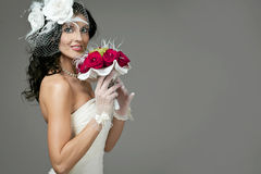Beautiful bride with red roses. Royalty Free Stock Image