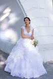 Beautiful bride. Rich bride in a wedding dress for a walk Royalty Free Stock Images