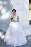 Beautiful bride. Rich bride in a wedding dress for a walk Stock Photos