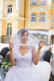 Beautiful bride. Rich bride in a wedding dress for a walk Stock Image
