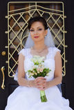Beautiful bride. Rich bride in a wedding dress for a walk Royalty Free Stock Photos
