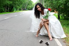 Beautiful bride at the road Royalty Free Stock Photography
