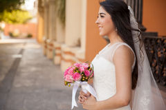 Beautiful bride with a rose bouquet Royalty Free Stock Photography