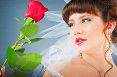Beautiful bride with rose in studio. Shooting Royalty Free Stock Photo