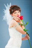 Beautiful bride with rose in studio. Shooting Royalty Free Stock Photography