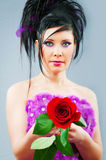 Beautiful bride with rose in studio Royalty Free Stock Image