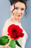 Beautiful bride with rose in studio. Shooting Royalty Free Stock Images