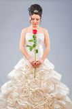 Beautiful bride with rose in studio stock photo
