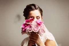 Beautiful bride with roses and orchid bouquet Royalty Free Stock Image