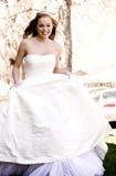 Beautiful Bride Running. A beautiful bride running toward the camera stock image