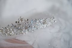 Beautiful bride`s crown is on the veil, close-up. Wedding day. Morning bride royalty free stock photography