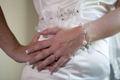 Beautiful bride's hand are on her waist Royalty Free Stock Images