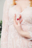 Beautiful bride`s hand in white negligee. Wedding. Youth. Purity Stock Photos