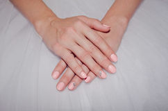 Beautiful bride`s hands with a gentle nail Stock Photos
