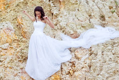 Beautiful bride among sands thoughtful Royalty Free Stock Images
