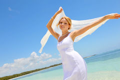Beautiful bride on a sandy beach Royalty Free Stock Image