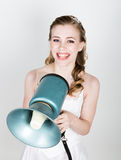 Beautiful bride screaming into a bullhorn. Wedding day. funny bride concept Royalty Free Stock Photography
