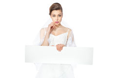 Beautiful bride showing hesitate poster. Royalty Free Stock Images