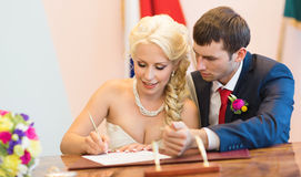 Beautiful bride sign up marriage certificate Stock Image