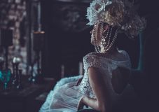 Beautiful bride sits on a chair. Luxury palace. Beautiful young bride sits on a chair. Luxury palace royalty free stock photos