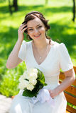Beautiful bride sitting on the bench Stock Photography