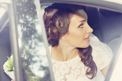 Beautiful bride sitting in the car Stock Photo