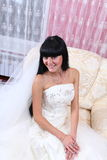 Beautiful bride sitting in chair Stock Photography