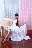 Beautiful bride sitting in chair Royalty Free Stock Photo