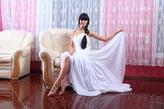 Beautiful bride sitting in chair Stock Images