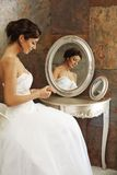 Beautiful bride sitting front of mirror Stock Photography